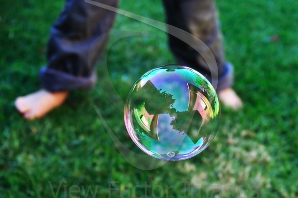 House reflection in soap bubble