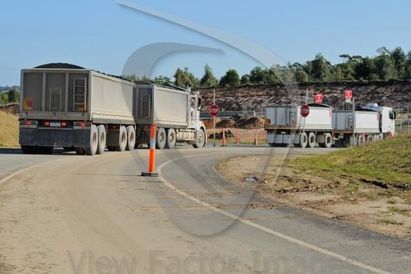 Construction trucks at turn