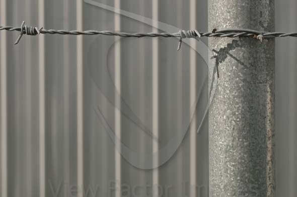 Barbed wire and wall