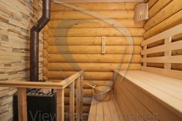 Log sauna with heater