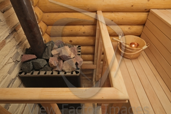 Wood-burning heater in sauna