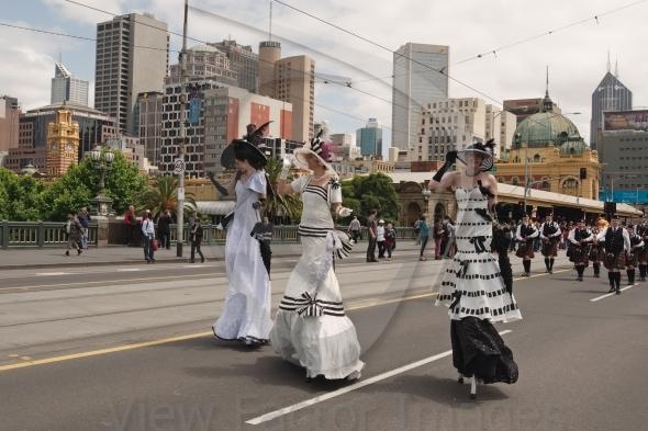 Ladies on stilts on parade