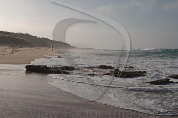 Surfer in morning dusk