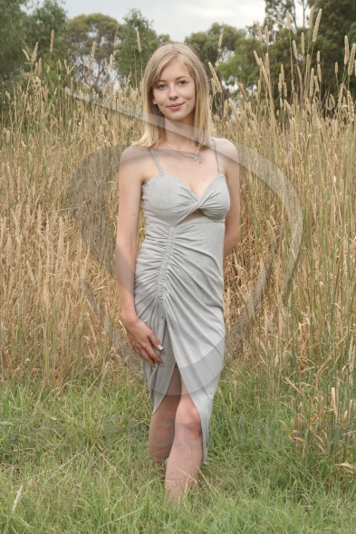Blond posing on grass