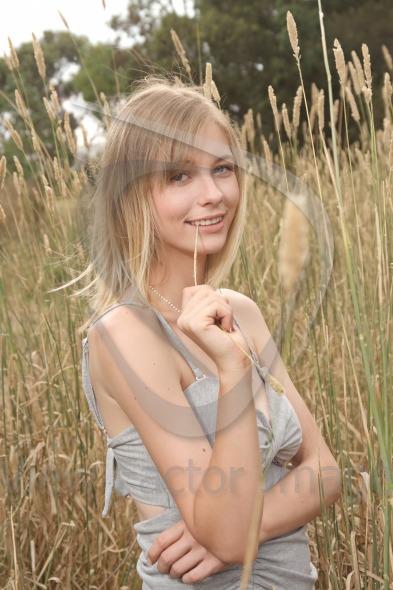 Blond holding straw