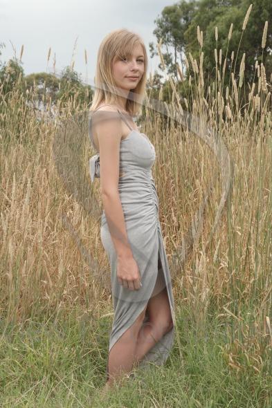 Blond near tall grass