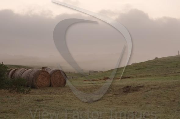 Haystack in fog dusk