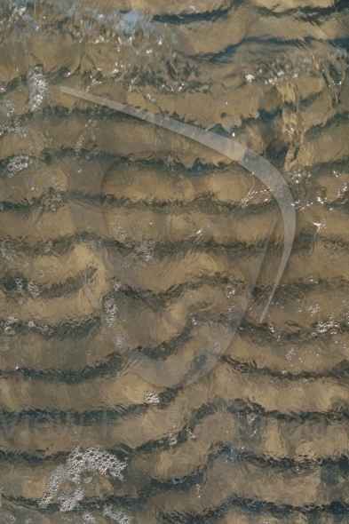 Wave over sand ripples