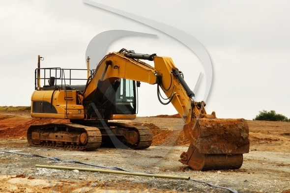 Excavator in red soil