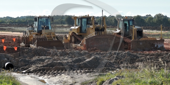 Three bulldozers