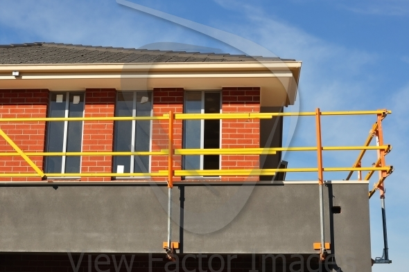 Bright scaffolds on new house