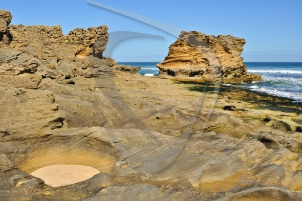 Sandstone rock on beach